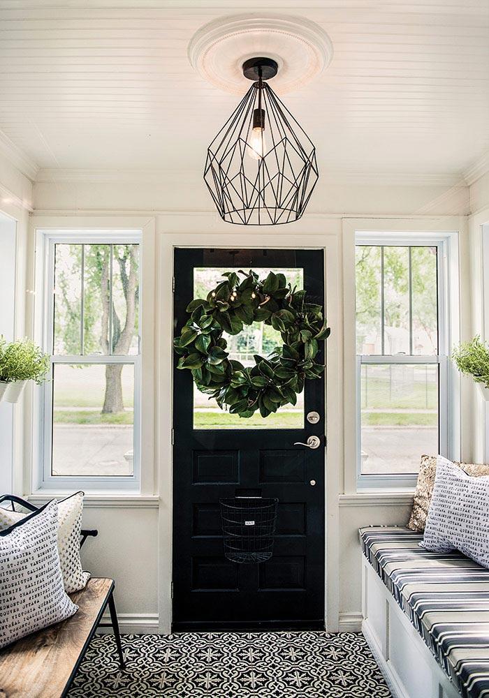 Heritage Door painted black with geometric pendant lamp