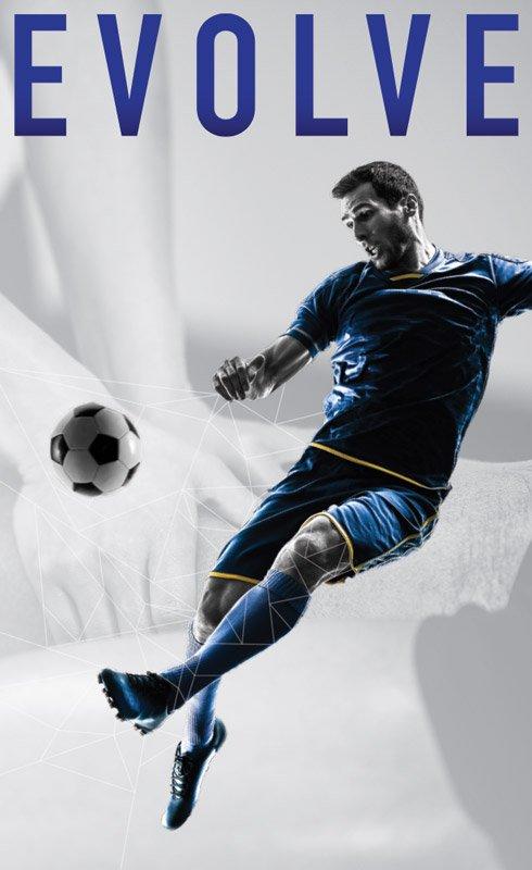 Man in blue jersey kicking a soccer ball